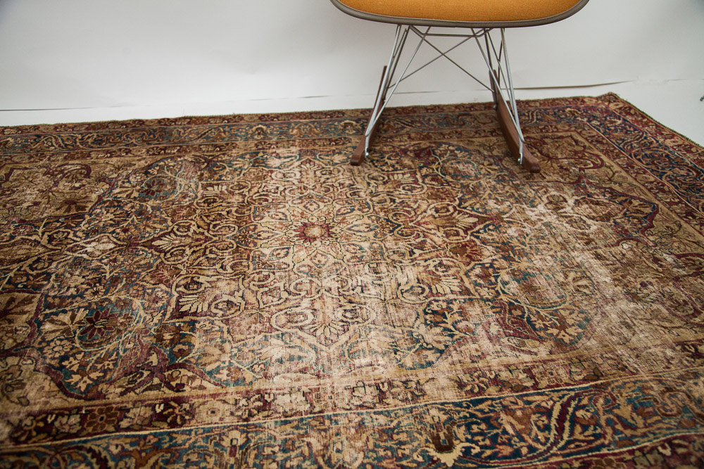 Antique distressed Persian Kerman Rug
