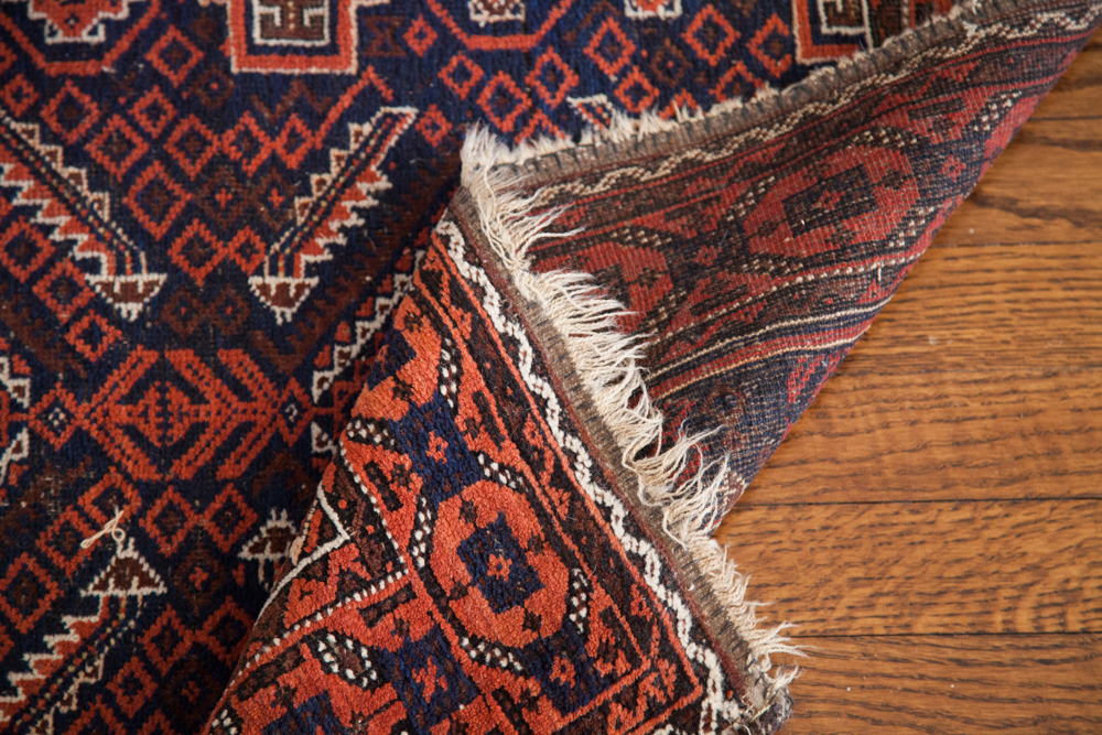 Vintage Antique Tribal Belouch rug